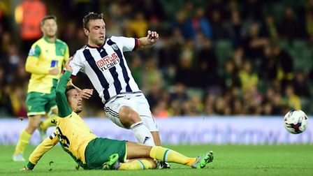 Rickie Lambert, pictured being tackled by Norwich City's Gary O'Neil, played all of West Brom's rece