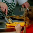 PARENTAL PERMISSION OBTAINED. Generic picture of a meal being served to a pupil at a Primary School