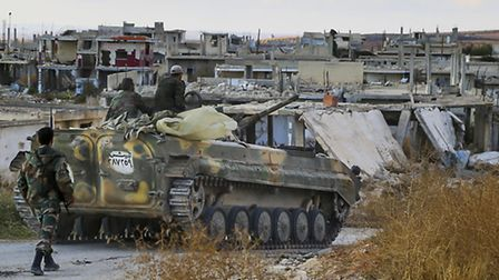 A Syrian army armored vehicle moves near the village of Morek in Syria. The Syrian army has launched
