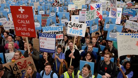 Demonstrators listen to speeches in Waterloo Place, London, during the 'Let's Save the NHS' rally an