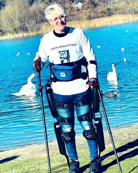 Simon Kindleysides, from Blofield, who is paralysed, after walking 125 miles in a robotic suit throu