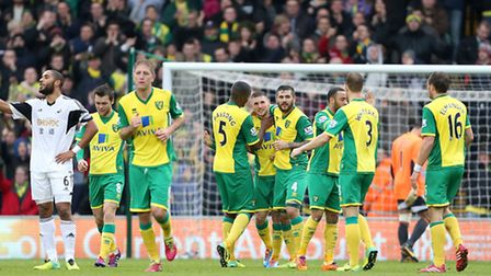 Norwich City players celebrate Gary Hooper's goal the last time Swansea City came to Carrow Road. Pi