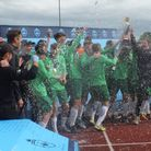 DESA's U18 team are celebrating after their victory in a national championship.