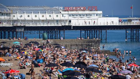 People enjoying the sunshine on Brighton beach. Wednesday could be the hottest day of the year so fa