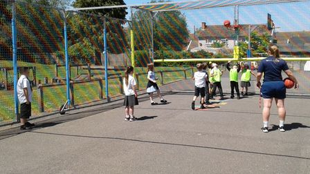 Children at Townley School in Christchurch playing inside the MUGA