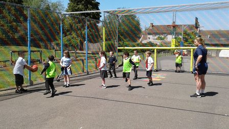 Children at Townley Primary School playing inside the MUGA