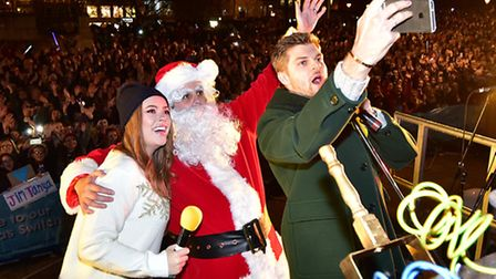 Norwich Christmas lights switch on. Tanya Burr and husband Jim Chapman take a selfie with Santa.Pict