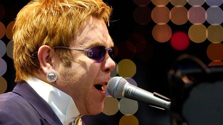 Elton John performing on the piano on stage at Carrow Road singing to thousands of people.Picture:
