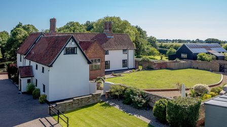 White farmhouse set in seven acres with huge lawns, a walled garden, woodlands and a moat