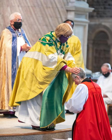 The Rt Revd Sarah Mullally Bishop of London lays hands on the new Bishop of Lynn.