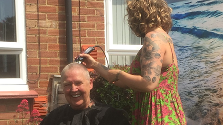 Gitte Fayers, from Swanton Abbott, had her head shaved to raise money forMacmillan Cancer Support.