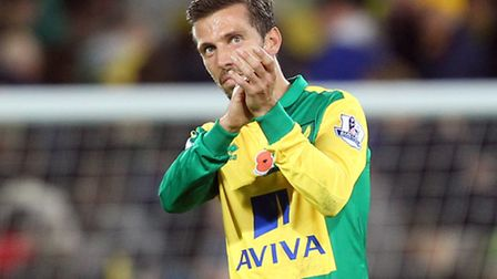 Gary ONeil of Norwich applauds the fans at the end of the Barclays Premier League victory over Swans