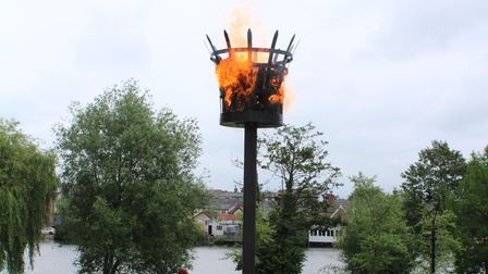 A 'beacon of hope' overlooking the mere has been lit for the first time in Diss Park