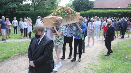 Tina Page coffin being carried into the church.