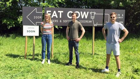 Lucy, Robbie, and Jack Spencer Ashworth outside the Fat Cow pop-up venue in Fakenham.