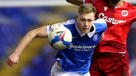 Birmingham City's Sam Cosgrove (left) and Reading's Liam Moore battle for the ball during the Sky Be