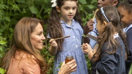 The Duchess of Cambridge gives children some honey to try during her visit to the Natural History Mu