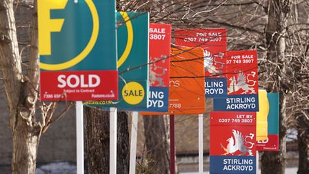 A row of Sold, For Sale and Let By signs. PRESS ASSOCIATION Photo. Picture date: Sunday March 1, 201