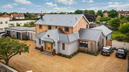 Huge contemporary home in a residential area set back on a shingle driveway