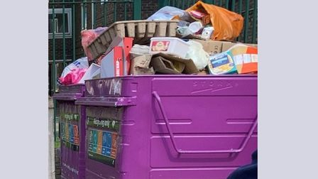 Overflowing waste such as pizza boxes and home delivery egg crates left uncollected.