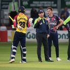 The umpires ask the players to leave the field in anticipation of a thunderstorm during the match between Essex andKent