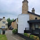 This mysterious giant tankard has appeared outside The High Flyer pub in Ely.
