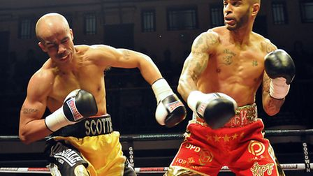 Leon McKenzie (red shorts) defeats Scott Douglas in his super-middleweight contest at York Hall, bac