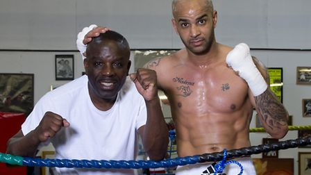 Leon McKenzie poses with his father, Clinton McKenzie, after a workout at his uncle's gym - the Duke