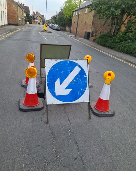 Four cones have been put in place around thesinkhole on New Road in Chatteris
