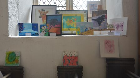 Paintings on display at the Worlington Movement exhibition