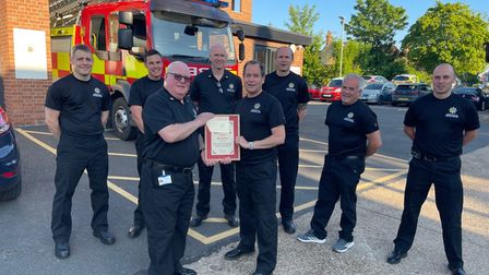 Crew manager Phil Spooner receiving a certificate from watch manager Tim Bray to mark 30 years of service.