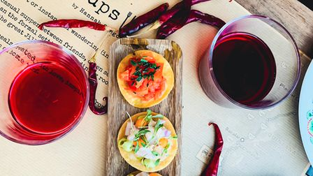 A platter of tacos served with red wine by Wandersups