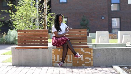 Michaela relaxes in the open grounds of Jolles House, her new home.
