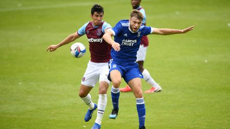 West Ham United's Fabian Balbuena (left) and Ipswich Town's Aaron Drinan battle for the ball during