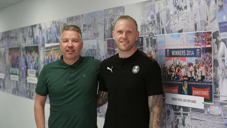 New Peterborough United goalkeeper David Cornell, pictured with manager Darren Ferguson