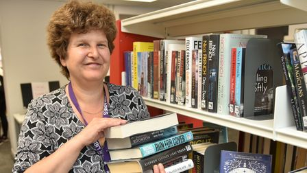 Saxmundham Library reopens in new premises.L- R Helen Scrivener, executive library manager Byline