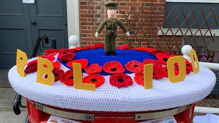 The knitted Post Box topper showing 100 years of the RBL in Great Dunmow