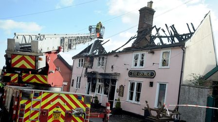 Firefighters at the scene of a fire at The George, Wickham Market, in 2013