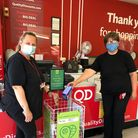 Staff members at QD's Gorleston store, pictured at the shop's food bank collection point