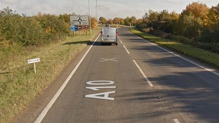 Personcut out of vehicle after car endsup trapped under a lorry on theA10 near Ely