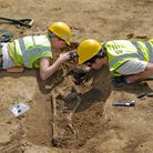 Bodies were unearthed at Knobb's Farm quarry in Somersham in east Cambridgeshire.