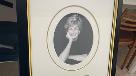 The signed photograph of the late Princess Diana will go under the hammer in aid of Tom's Trust.