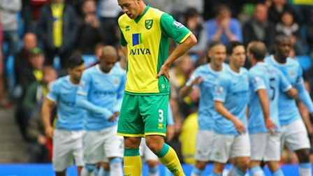 Steven Whittaker is one of the Norwich City players with mixed memories of trips to Manchester City.