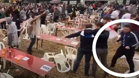 One England fan got so excited to see England score he didn't seem to notice the plastic chair stuck on his leg.