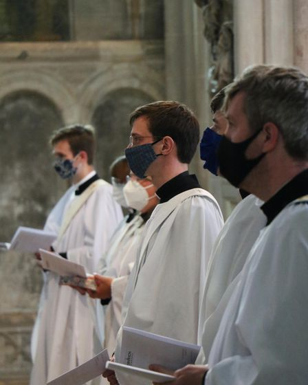 The ordinands stand, ready to come forward and be ordained priests. PIcture: Diocese of Norwich