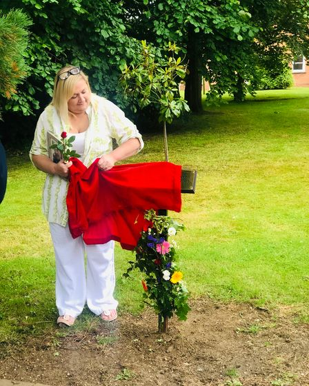 Jo Sheldrake was invited to unveil the plaque of the new garden after she campaigned for a memorial garden in the town