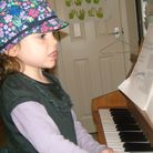 Ruby Lambert turns to music as a child in her recovery frombrain injury
