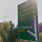 A Google Street View screenshot showing: A green sign: B. Stortford, Stansted, A120 one way; Great Dunmow, B184 the other.