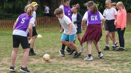 Pupils from Kelsale Primary School taking part in a football session lead by Tom Ling, from Ipswich