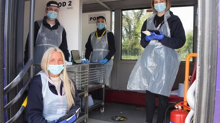 The team of testing operatives on the new Covid-19 mobile testing bus for observed lateral flow test